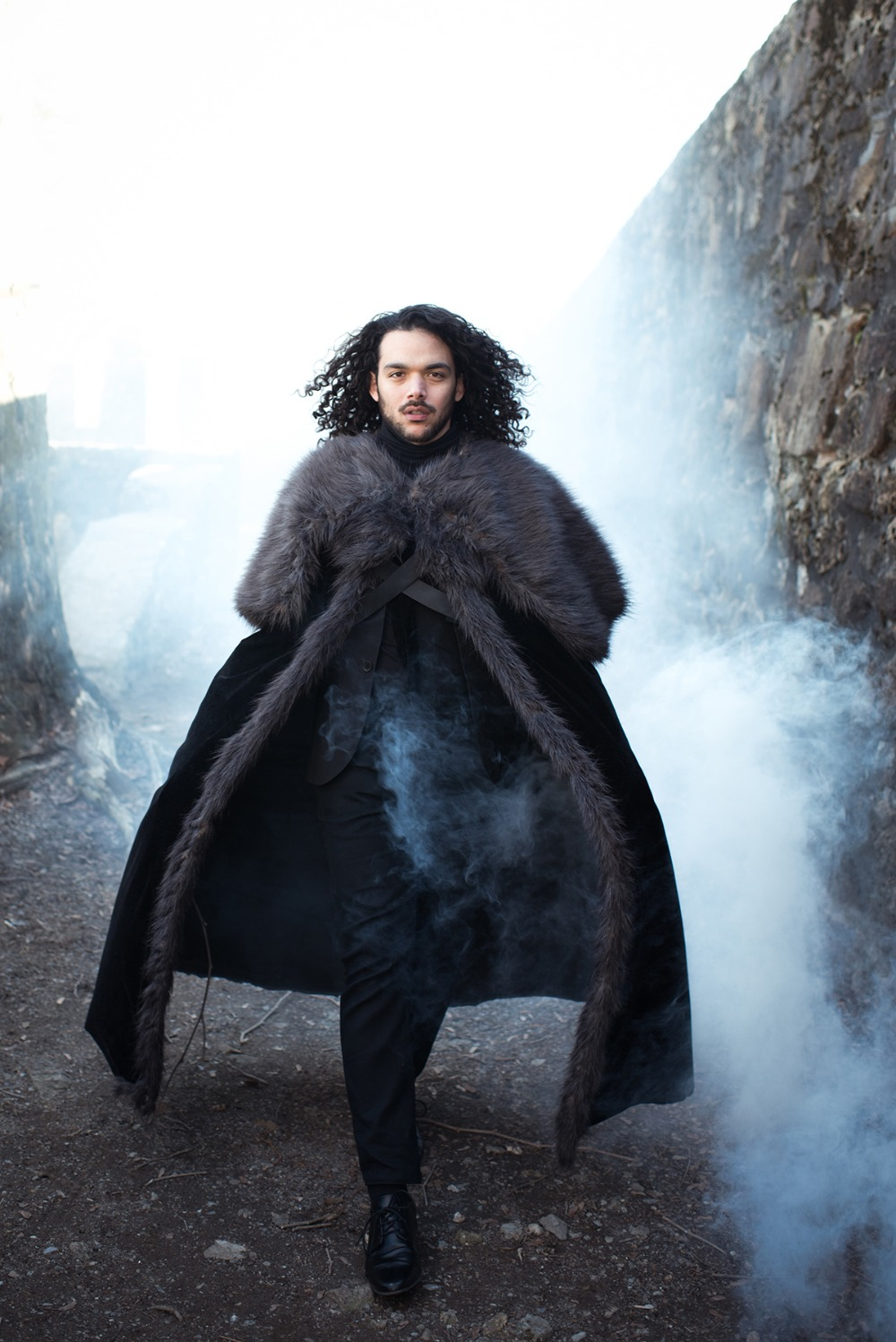a total black groom's outfit with a fur coverup is a gorgeous idea for a modern take on Jon Snow's look