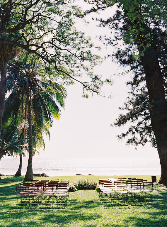 The ceremony space was facing the sea, there was a chic semi circular wedding altar done with bright blooms