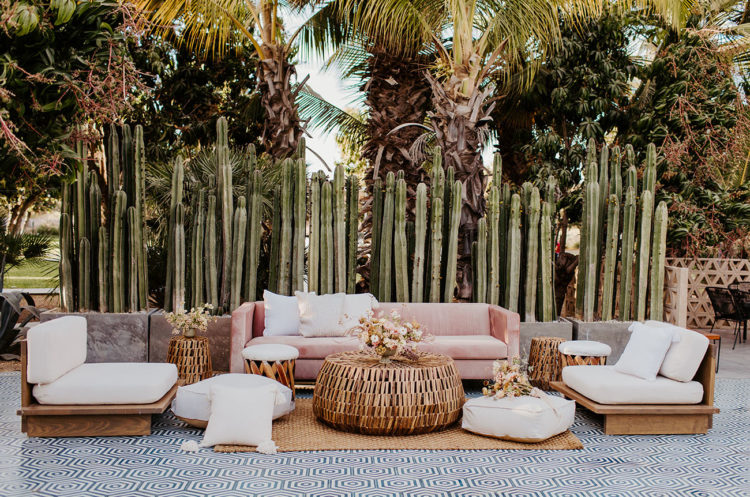 The second lounge was done in white and pink, rattan and wooden furniture and cacti around it