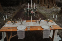 09 The wedding tablescape was done with an ethereal runner, floral plates, greneery and blooms, a candelabra decorated with florals