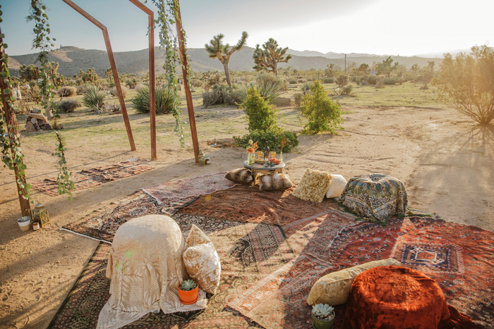 There was also a picnic setting with rugs, ottomans and pillows and potted succulents