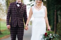 09 a burgundy checked three-piece wedding suit, a white shirt, a burgundy velvet bow tie and teal tassel loafers