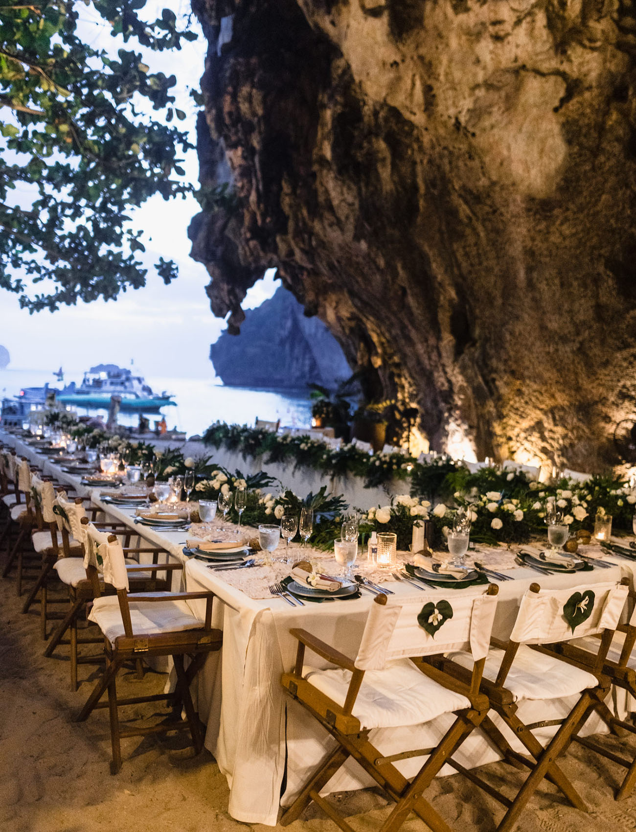 wedding tables decorated with tropical leaves