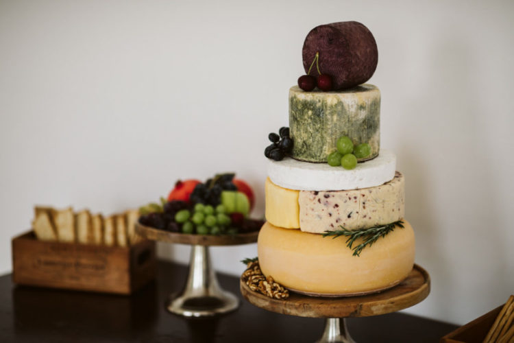 The wedding cake was skipped for a cheese wheel one, topped with fresh berries