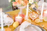 10 The wedding tablescape featured crystal candle holders, citrus slices, pink candle holders and chic floral centerpieces