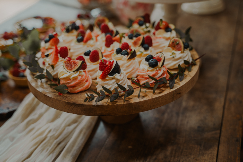 Pavlovas topped with fresh fruits and berries