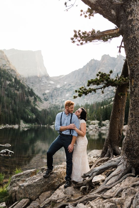 a mountain lake elopement with gorgeous views of the peaceful lake and mountains surrounding it