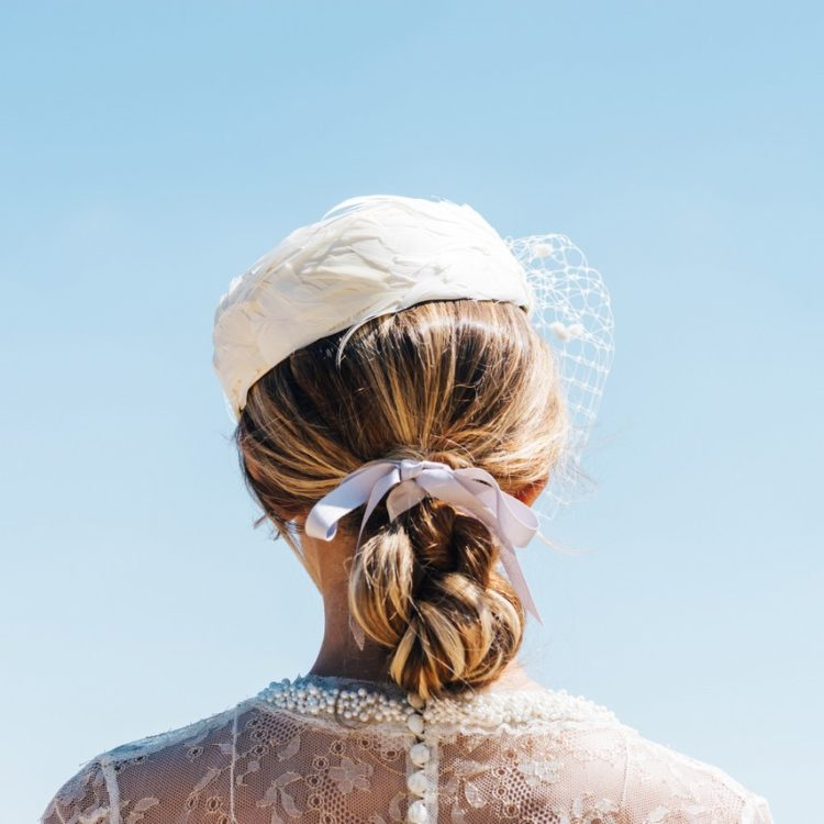 wearing a ribbon in your hair on your wedding day, doesn't have to mean skipping other accessories, a wedding hat or veil