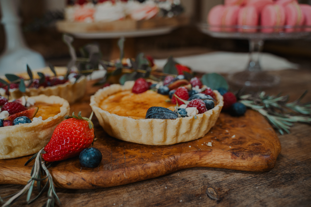 Fresh berry tarts are a delicious idea for a boho wedding