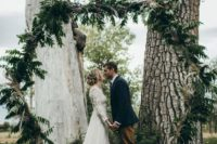 12 a hexagon wedding arch fully covered with greenery and ferns will be a perfect match for a woodland wedding