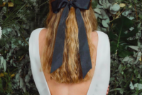 12 thick black ribbon adds such a stylish touch to this classic half-up, half-down hairstyle