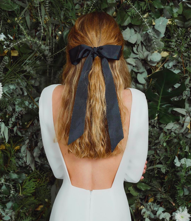 thick black ribbon adds such a stylish touch to this classic half-up, half-down hairstyle