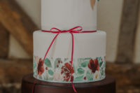 13 The wedding cake was done with three tiers, one chocolate, one floral and one white, with sugar blooms on top