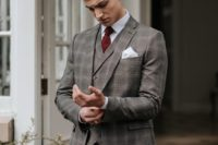 14 a grey checked three-piece suit, a white shirt, a burgundy bow tie and a brown belt for a touch of vintage