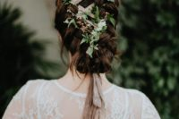 15 a unique braided low updo with a blush ribbon and fresh greenery interwoven looks very eye-catchy and boho