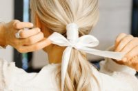 16 a low ponytail plus a ribbon hair wrap and a bow to highlight your hairstyle and make it catchy