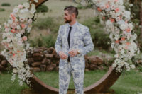 18 a blue floral print suit, a white shirt, a black tie and black shoes with no socks for a summer groom
