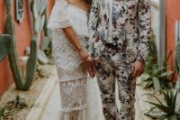 19 a bright floral print suit and a matching tie, a white shirt, brown loafers for a tropical groom's look