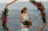19 a bright polygon wedding arch decorated with pink blooms and lush greenery for a summer wedding