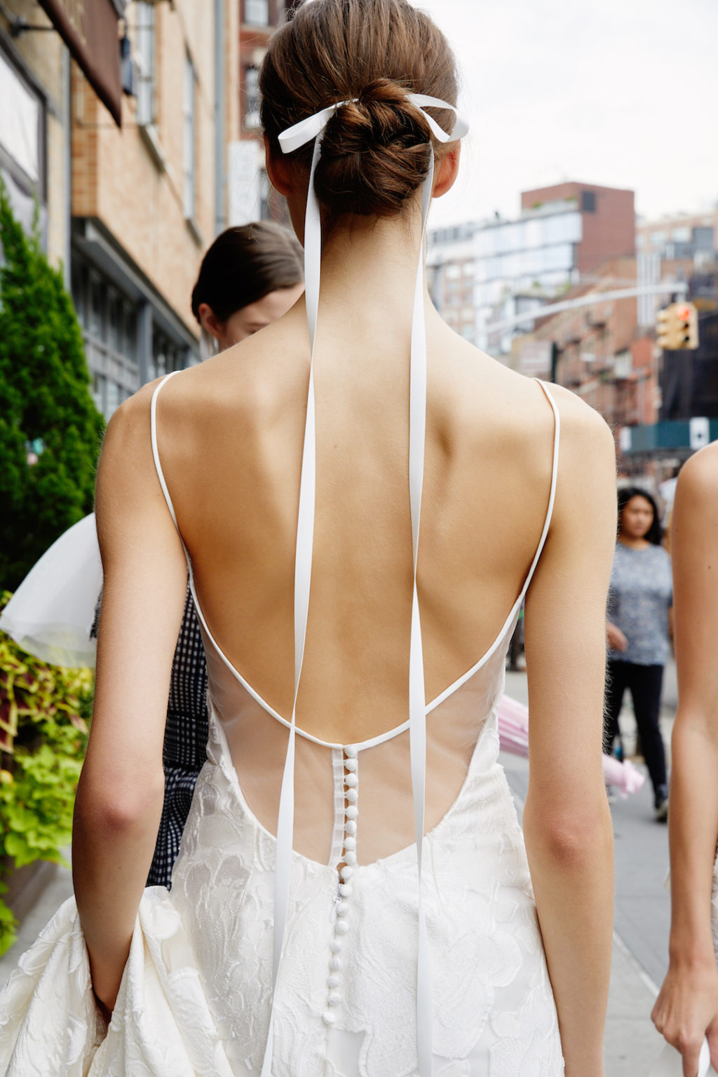 keep you ribbon extra long and add some drama to a ribbon tied bun, great for a minimalist bridal look