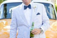 23 a blue thin stripe suit, a white shirt, a navy polka dot bow tie for a nautical or beach wedding