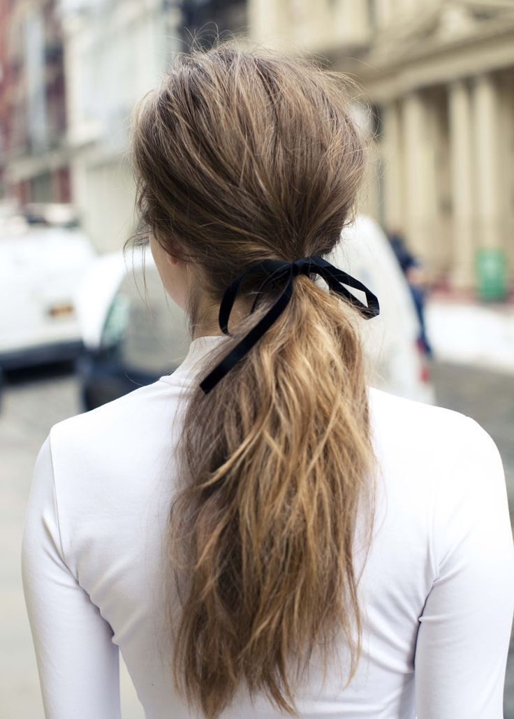textured ponytails have been a big trend in wedding hair, just add a ribbon for a trendier look