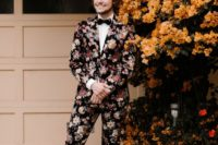 26 a moody floral suit, a white shirt, a black bow tie and burundy shoes is a bold option for a fall wedding
