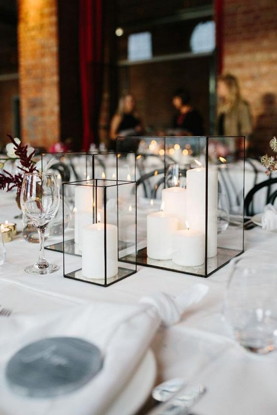 geometric black candle lanterns with white pillar candles are all that you need to create a mood and add decor