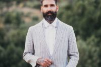 29 a relaxed boho groom look with a neutral striped linen suit and a white shirt for a hot day