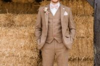 30 a striped brown three-piece tweed suit, a white shirt, a blush bow tie and brown shoes for a rustic wedding