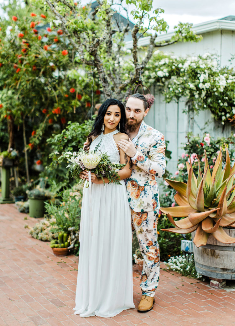 a super colorful floral suit with a white shirt and no tie, amber shoes for a colorful tropical wedding
