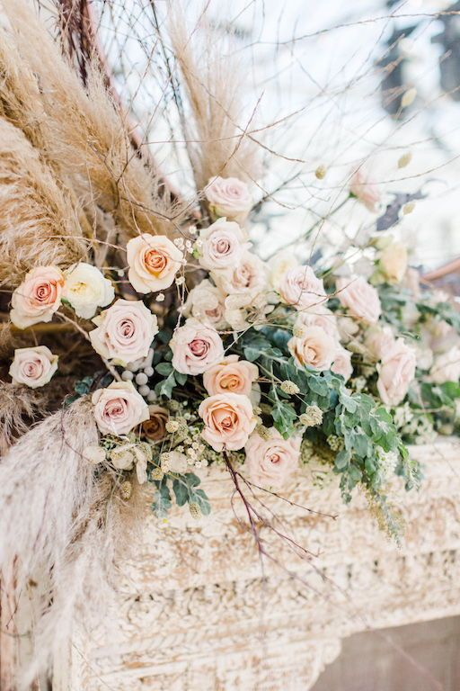 a beautiful natural blush pink roses arrangement with full greenery, lunaria and pampas grass looks unique