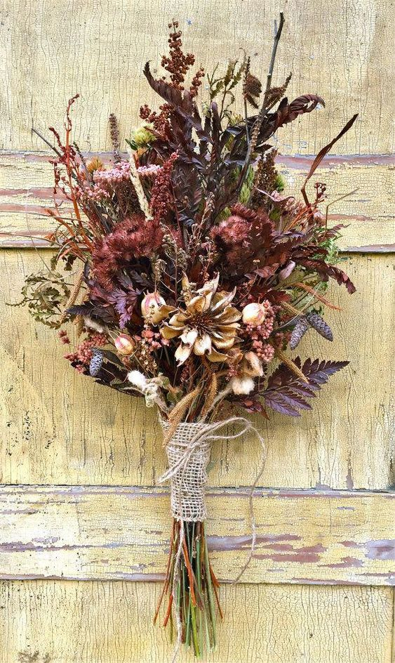a colorful fall wedding bouquet with dried herbs, blooms, wheat, greenery and a burlap wrap for a rustic feel