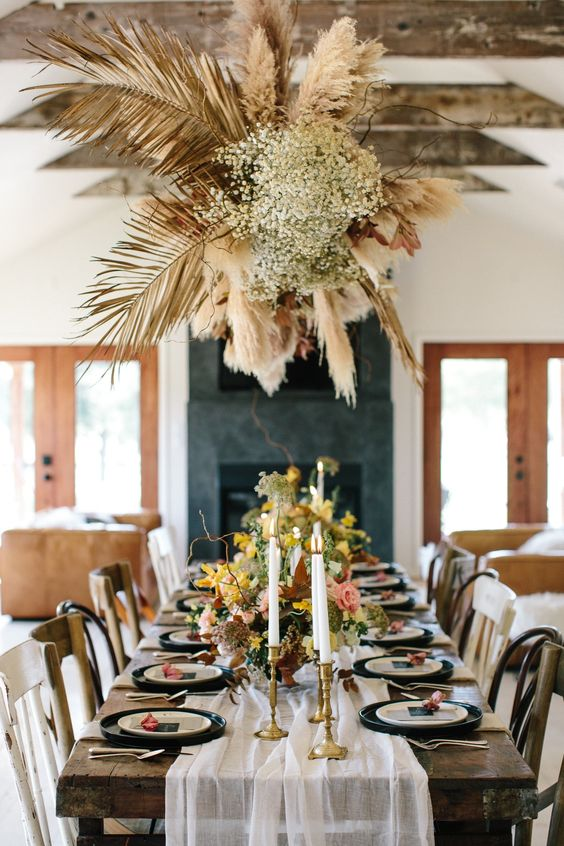 a fantastic overhead arrangement of dried palm leaves, pampas grass and baby's breath brigns that wow factor