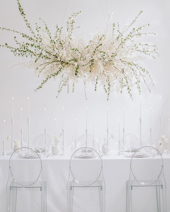 a fantastic overhead lunaria and greenery wedding decoration will highlight your reception and make it look wow