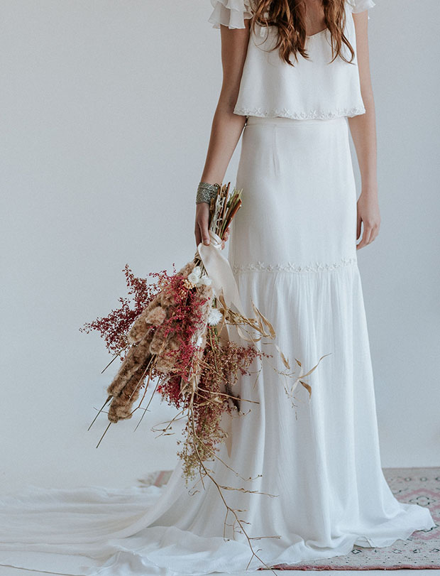 a gorgeous boho wedding bouquet with dried blooms, herbs, branches and berries plus delicate silk ribbons