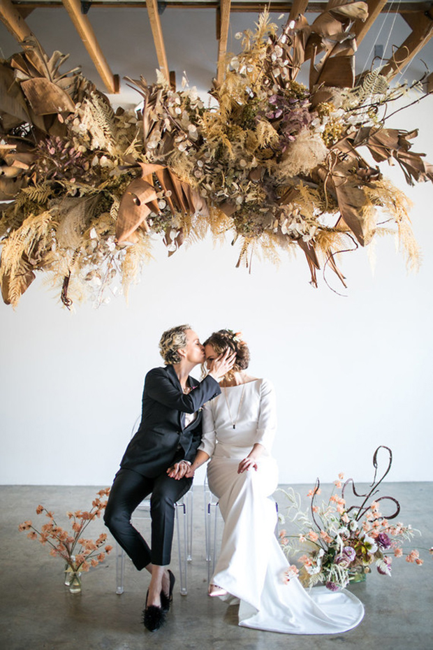 a jaw-dropping wedding ceremony installation fully of dried herbs, leaves, blooms, branches and other stuff to make a statement
