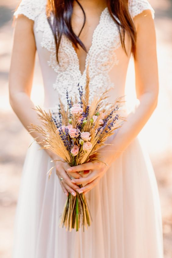 a rustic boho wedding bouquet with wheat, lavender and little blush roses is a cute idea for summer or fall