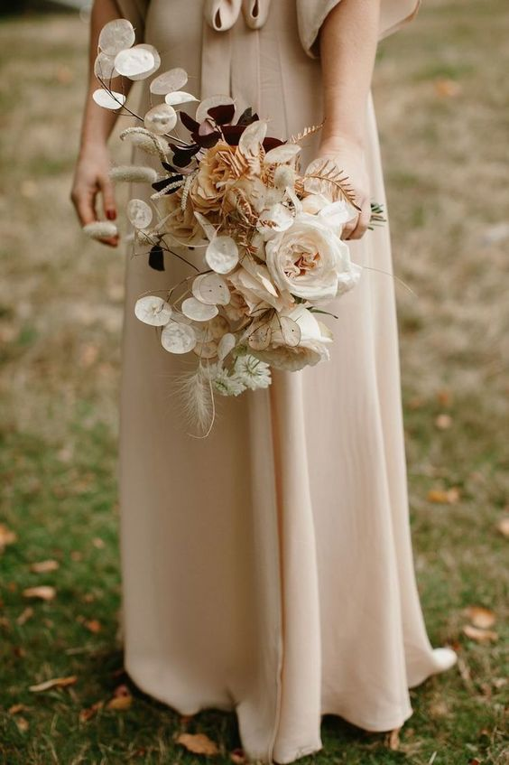 a sophisticated wedding bouquet with lunaria, dried herbs, blush and white blooms