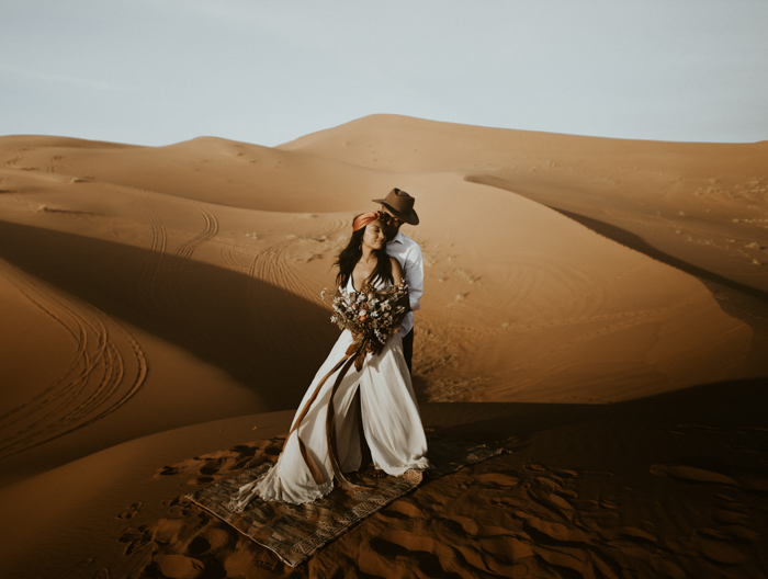 This beautiful Moroccan wedding shoot took place right Sahara desert and it felt truly boho and wild