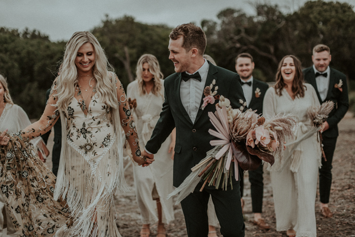 This boho glam wedding in Australia is all neutral, with lots of dried herbs and blooms and pampas grass