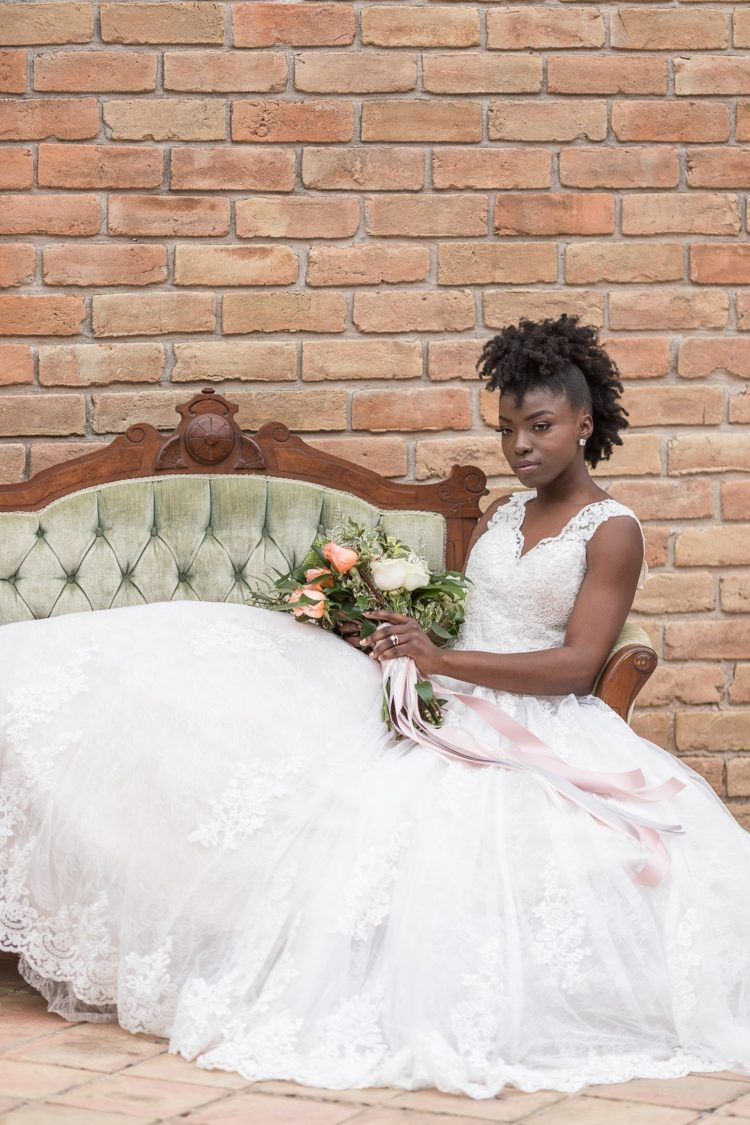 The bride was wearing a lace wedding ballgown with a V-neckline, thick straps and stateent earrings