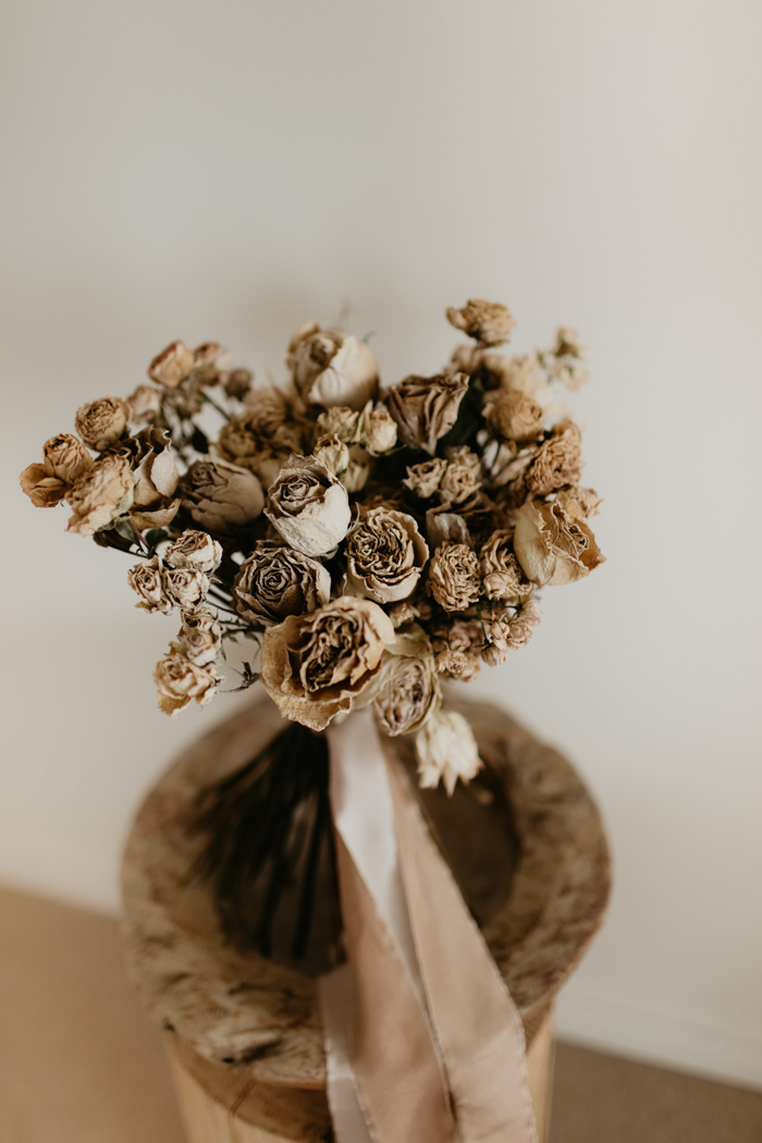 The wedding bouquet was done with dried blooms with earthy ribbons