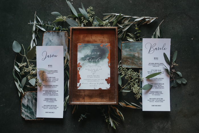 The wedding invitations were done in industrial style, too, with copper leaf and watercolors