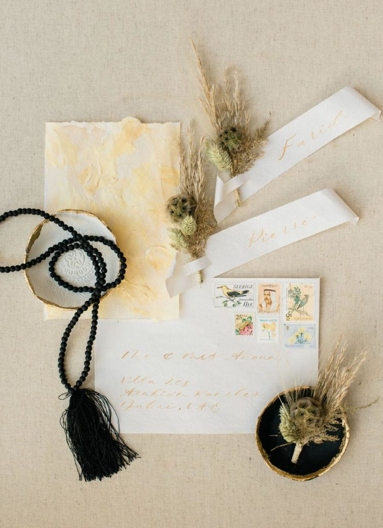 The wedding stationery incorporated yellows and mustard - the colors that were incorporated into the shoot decor