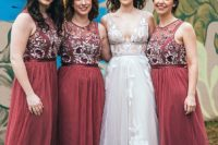 03 The bride was wearing a romantic blush wedding gown with thick straps and white lace appliques, the gals were rocking burgundy maxi dress wih contrasting floral embroidery and no sleeves