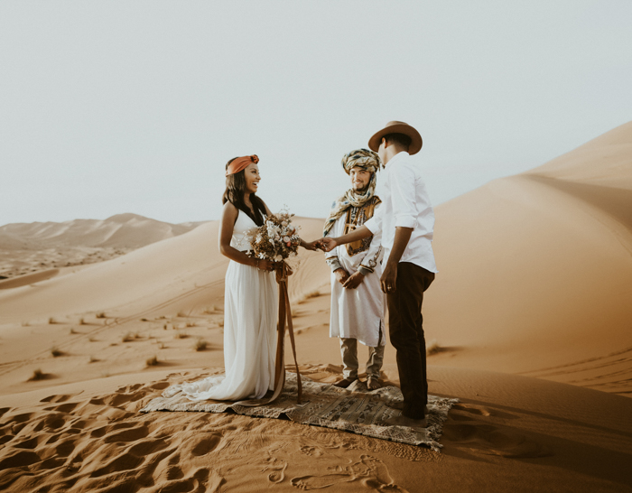The ceremony took place right in the desert, in the dunes, there was a boho rug and nothing else