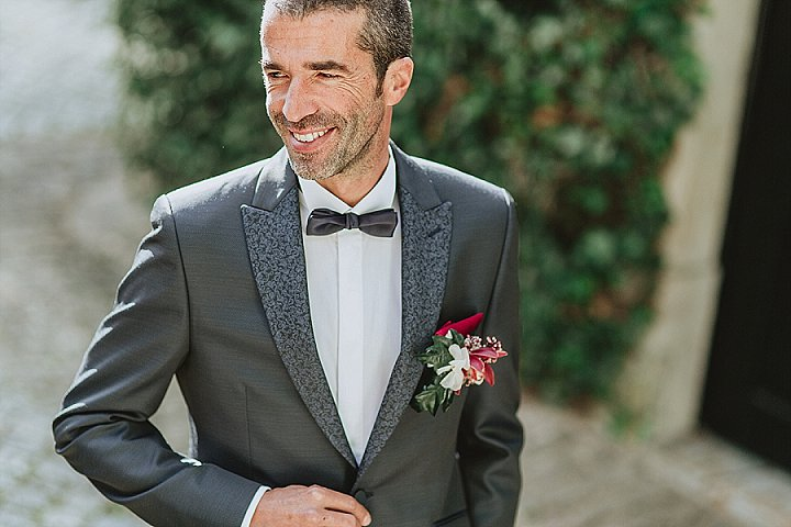 The groom was wearing a grey tux with printed lapels