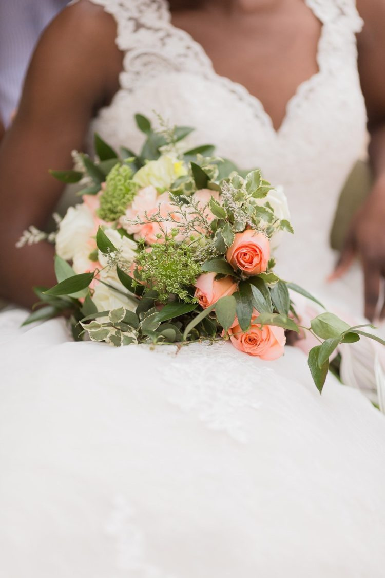The wedding bouquet was done with neutral and coral pink blooms and greenery