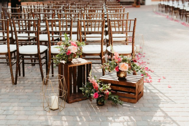 Geometric touches, pink bougainvillea and peachy blooms were used to decorate the wedding